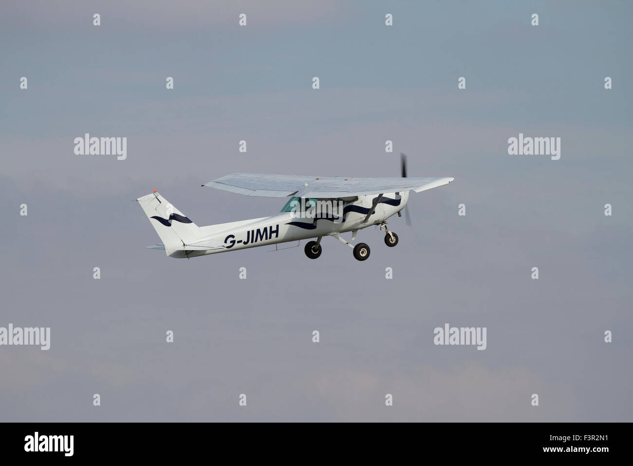 Single engined light aircraft just after take off from Wolverhampton Halfpenny Green Airport. - Stock Image
