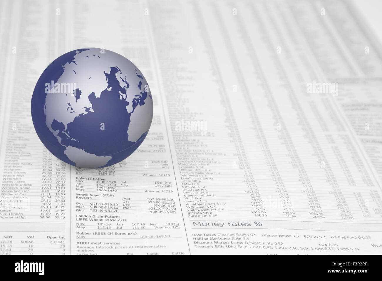 Map of the world globe on a news paper stock market financial page map of the world globe on a news paper stock market financial page showing stocks and shares gumiabroncs Images