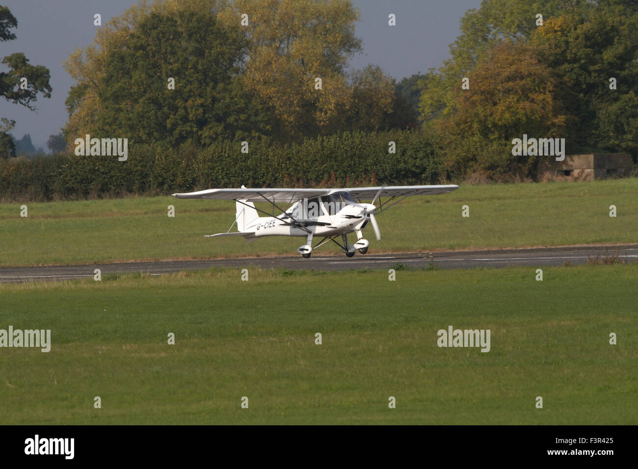 single engined light aircraft landing at Wolverhampton Halfpenny Green Airport. UK - Stock Image