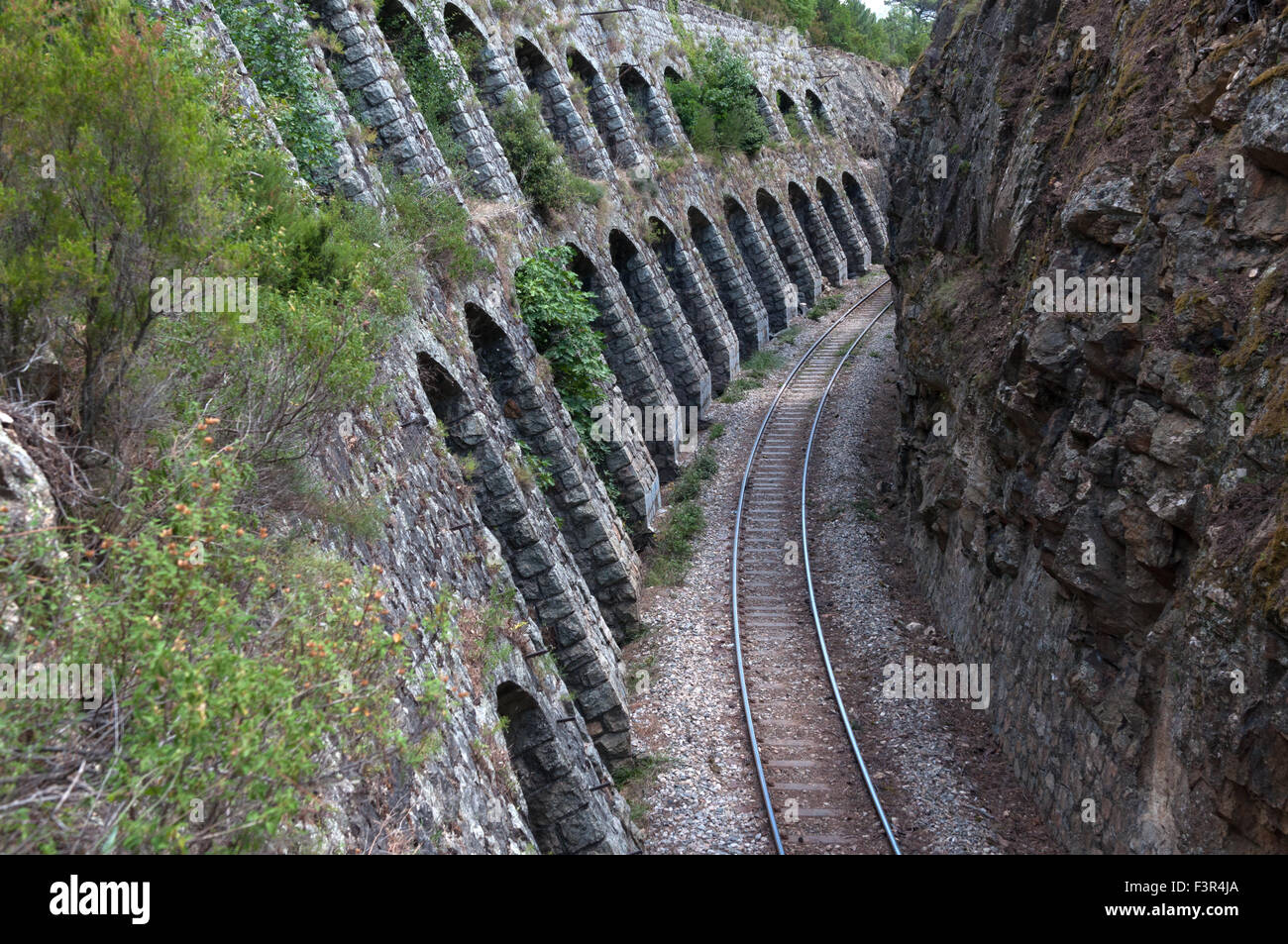 Bottleneck passage close to Ponte du Vecchio rail bridge on Ajaccio-Bastia railway, near Vivario, Corsica, France - Stock Image