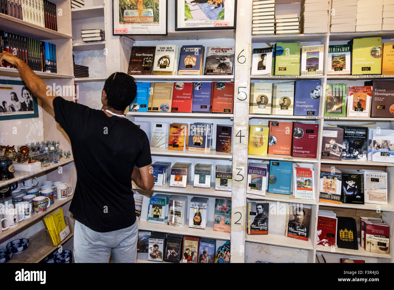 Florida Key West Keys Whitehead Street The Ernest Hemingway Home and Museum gift store shopping books man Stock Photo