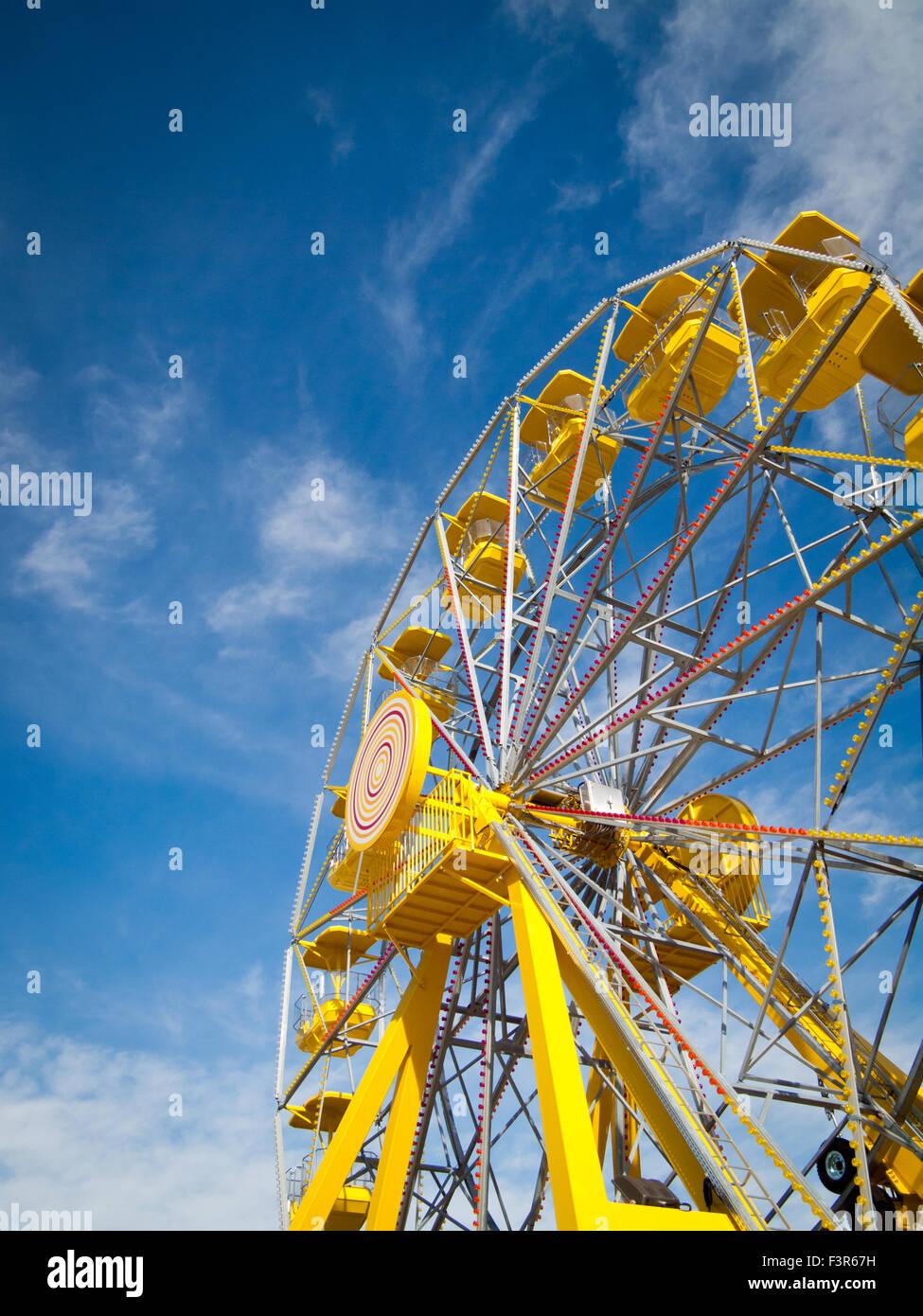 The yellow ferris wheel at the PotashCorp Playland at Kinsmen Park in Saskatoon, Saskatchewan, Canada. Stock Photo