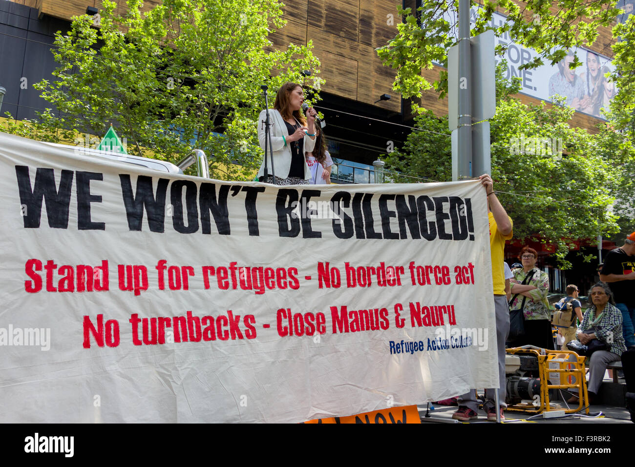 Melbourne, Australia. 11th Oct, 2015. #StandUp4Refugees activists marched across Melbourne after a rally outside - Stock Image