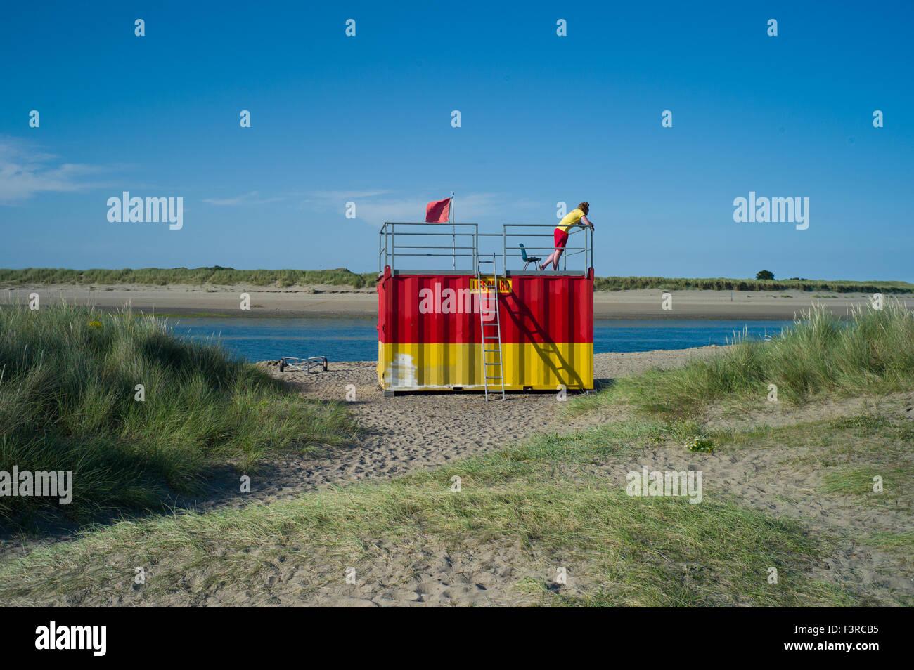 Lifeguard on watch at Malahide, Dublin - Stock Image
