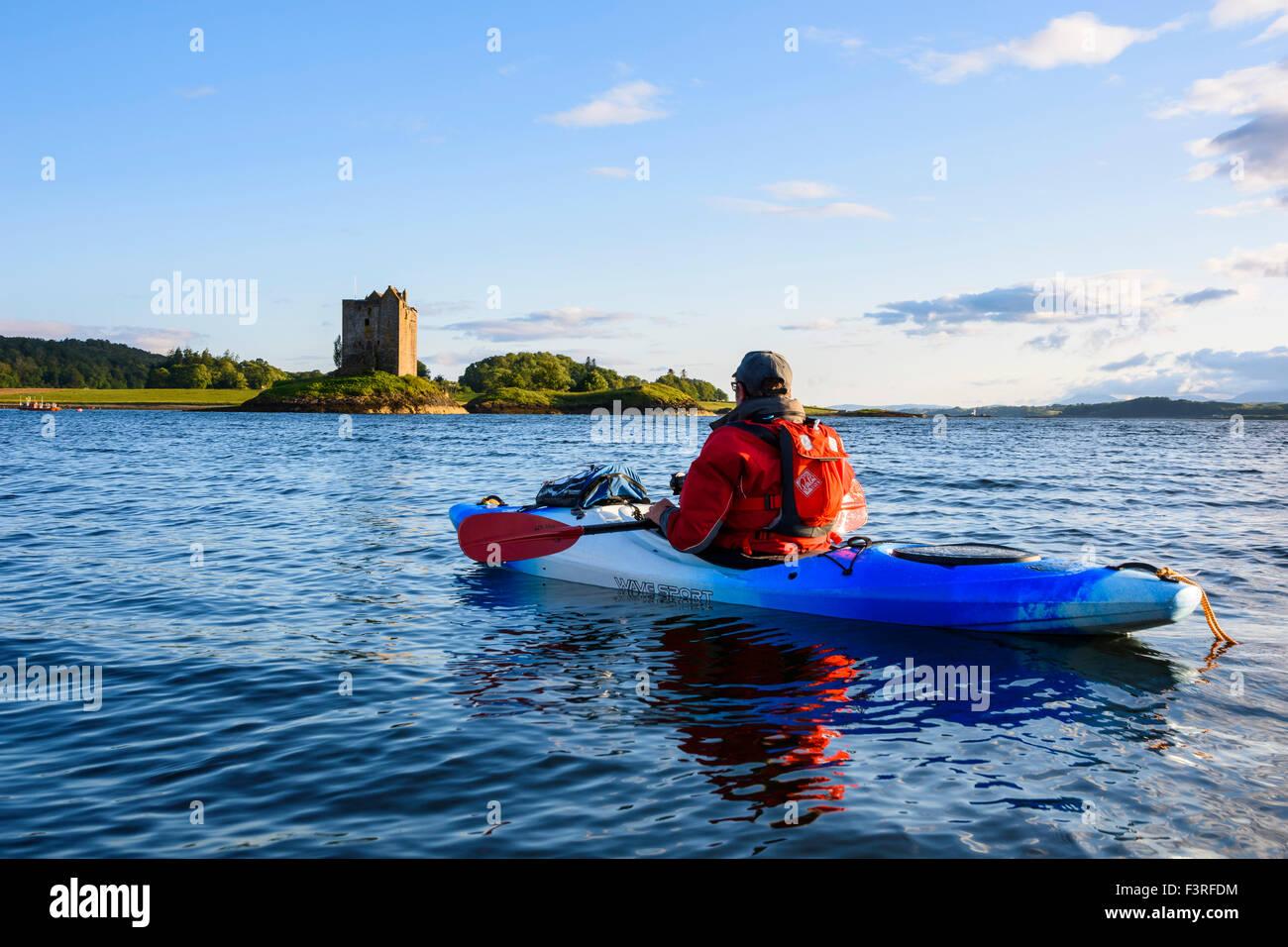 Kayaking around Castle Stalker, near Appin, Argyll & Bute, Scotland - Stock Image