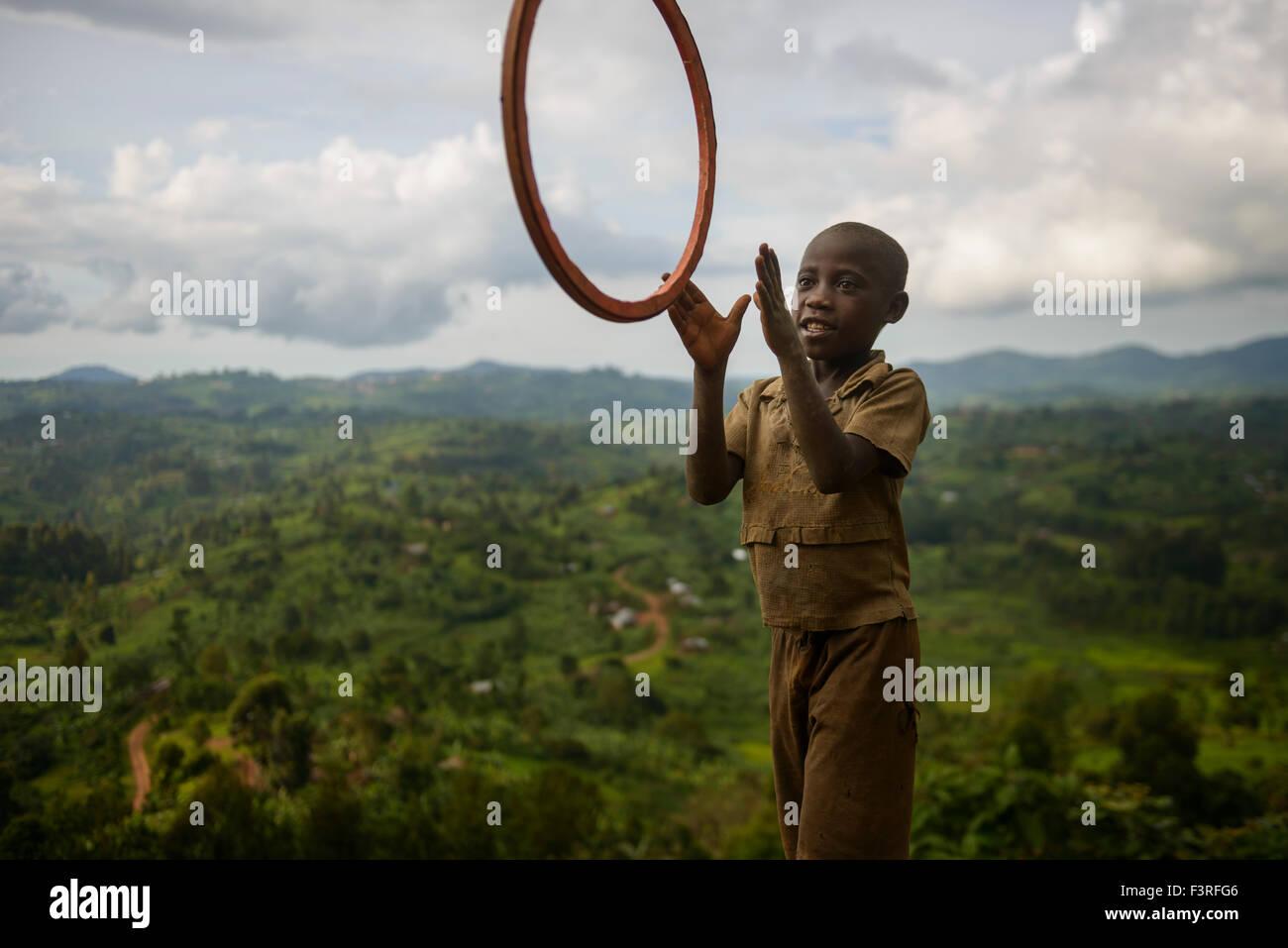 Kid playing with a hoop, Uganda, Africa - Stock Image
