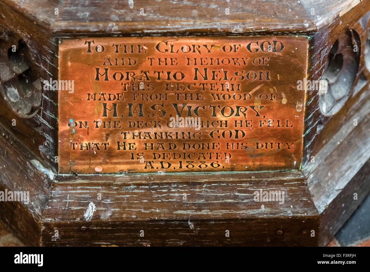 Plaque on lectern in All Saints Church, made from wood from Nelson's flagship HMS Victory, Burnham Thorpe, Norfolk, - Stock Image
