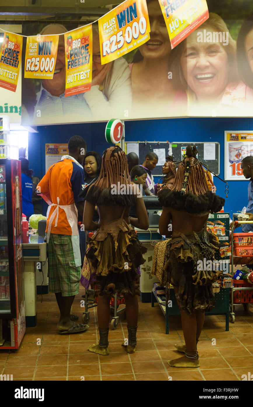 Women of the Himba tribe in the supermarket, Opuwo, Namibia, Africa - Stock Image