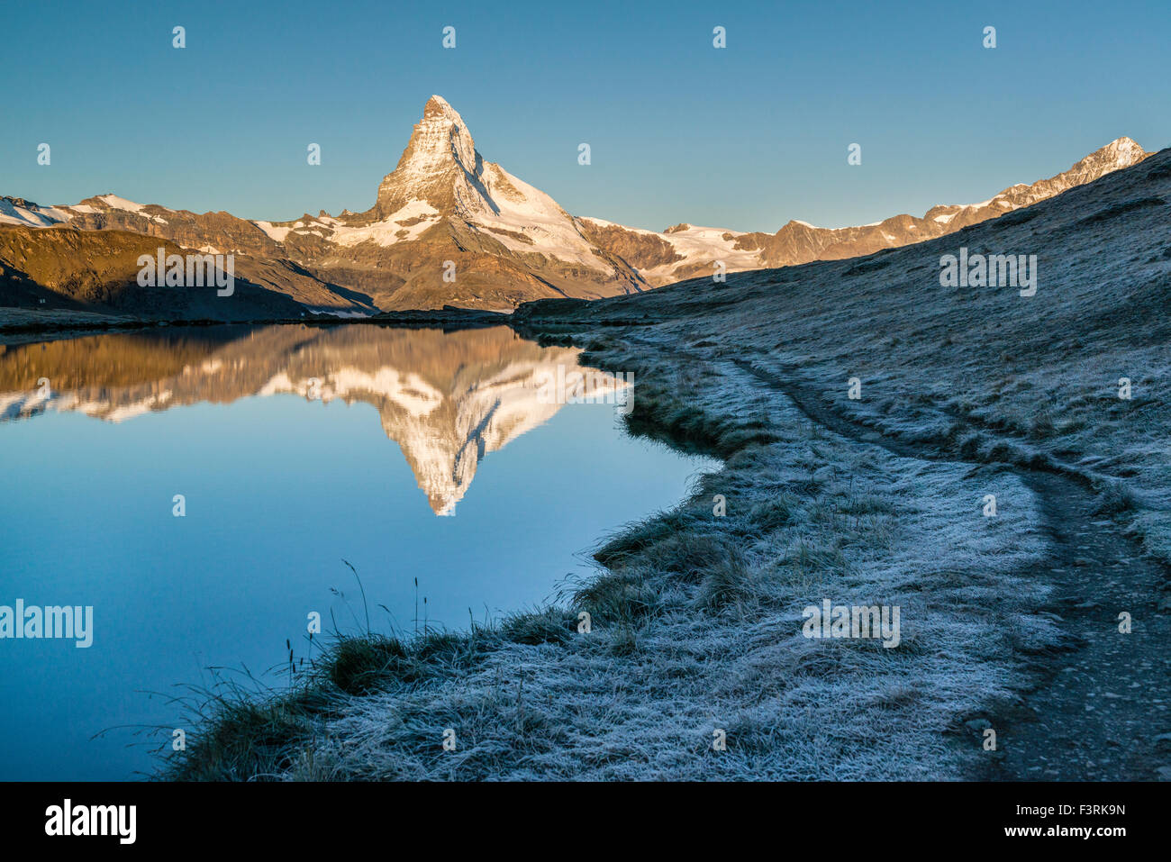Reflection of the Matterhorn in Stellisee with hoarfrost, Switzerland - Stock Image