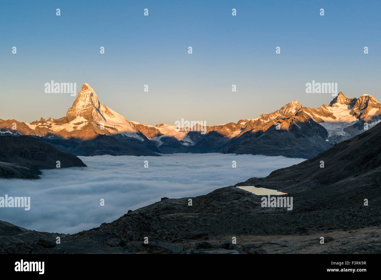 Matterhorn with clouds at sunrise, Switzerland Stock Photo
