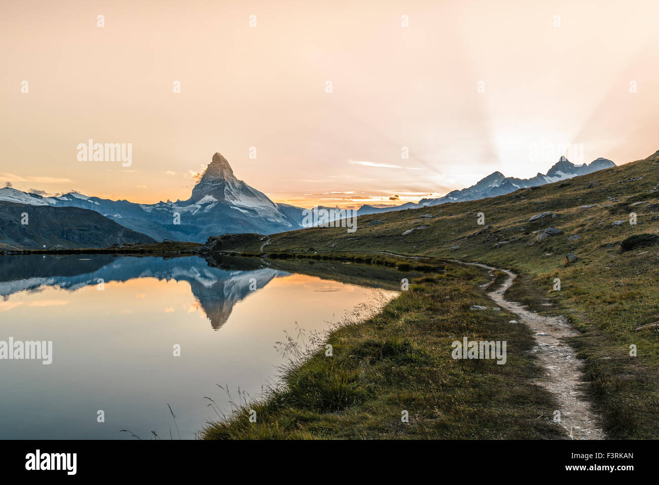 The Matterhorn reflected in Stellisee at sunset - Stock Image