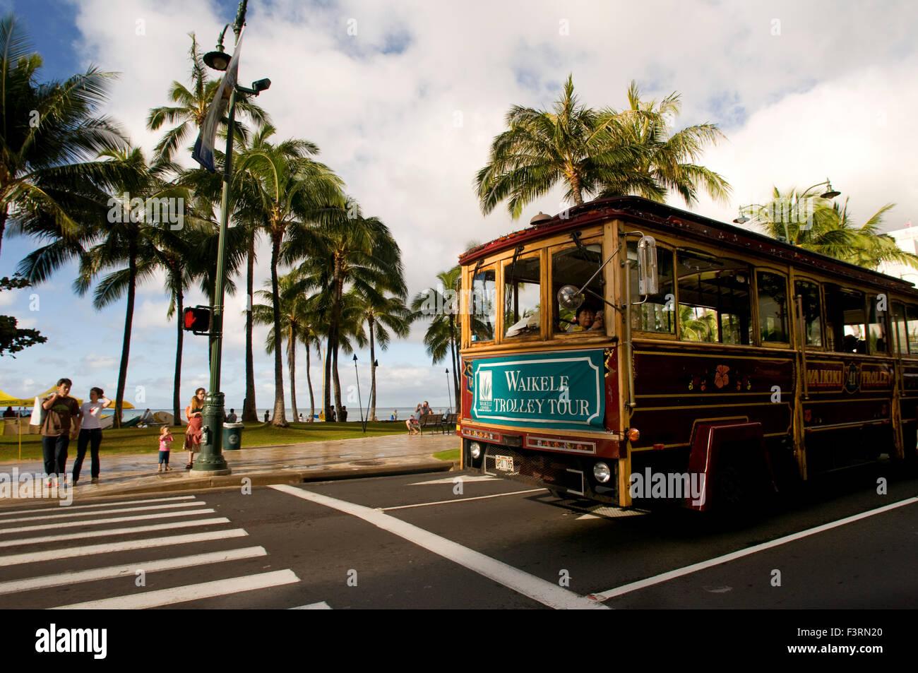 Waikiki Trolly, tourist bus shopping that runs between Waikiki and Honolulu. O'ahu. Waikiki Trolley Trolley - Stock Image