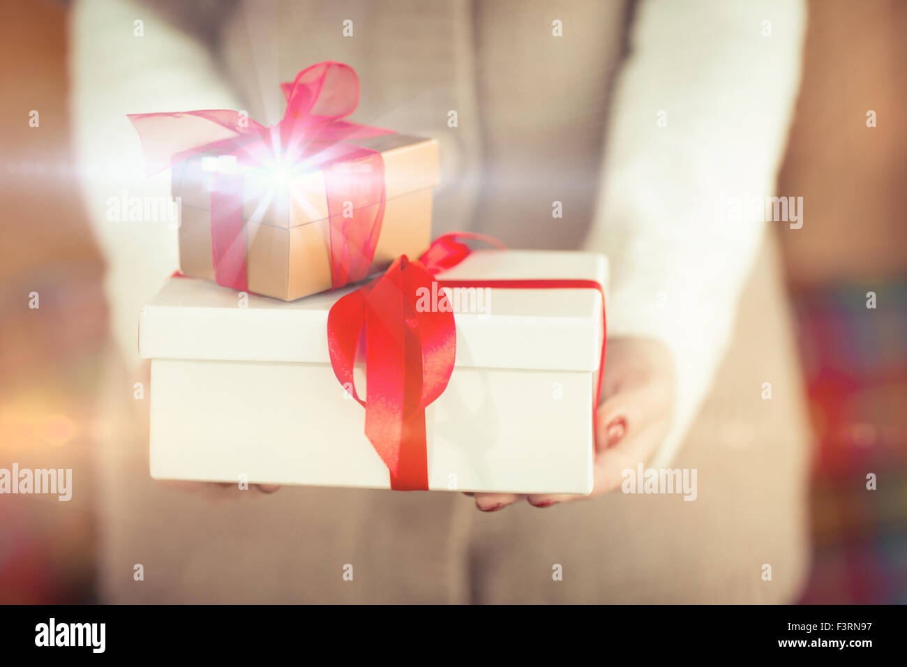 Woman with nail varnish holding gifts - Stock Image