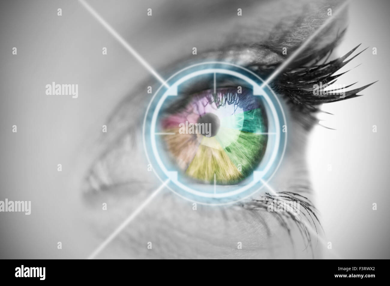 Multi colored eye on grey face - Stock Image