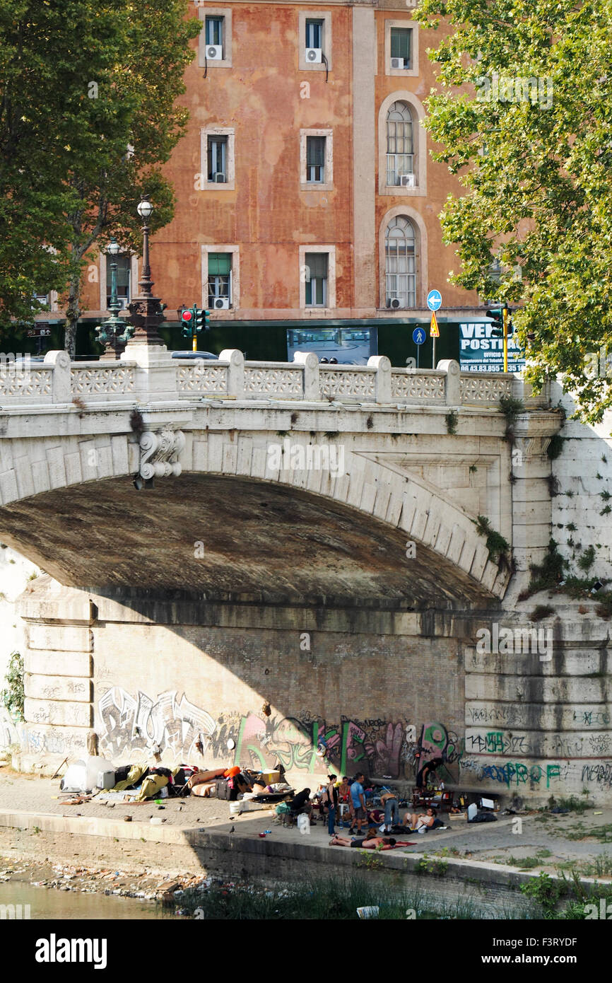 A group of itinerants camped under the bridge, Ponte Mazzini, in Rome - Stock Image