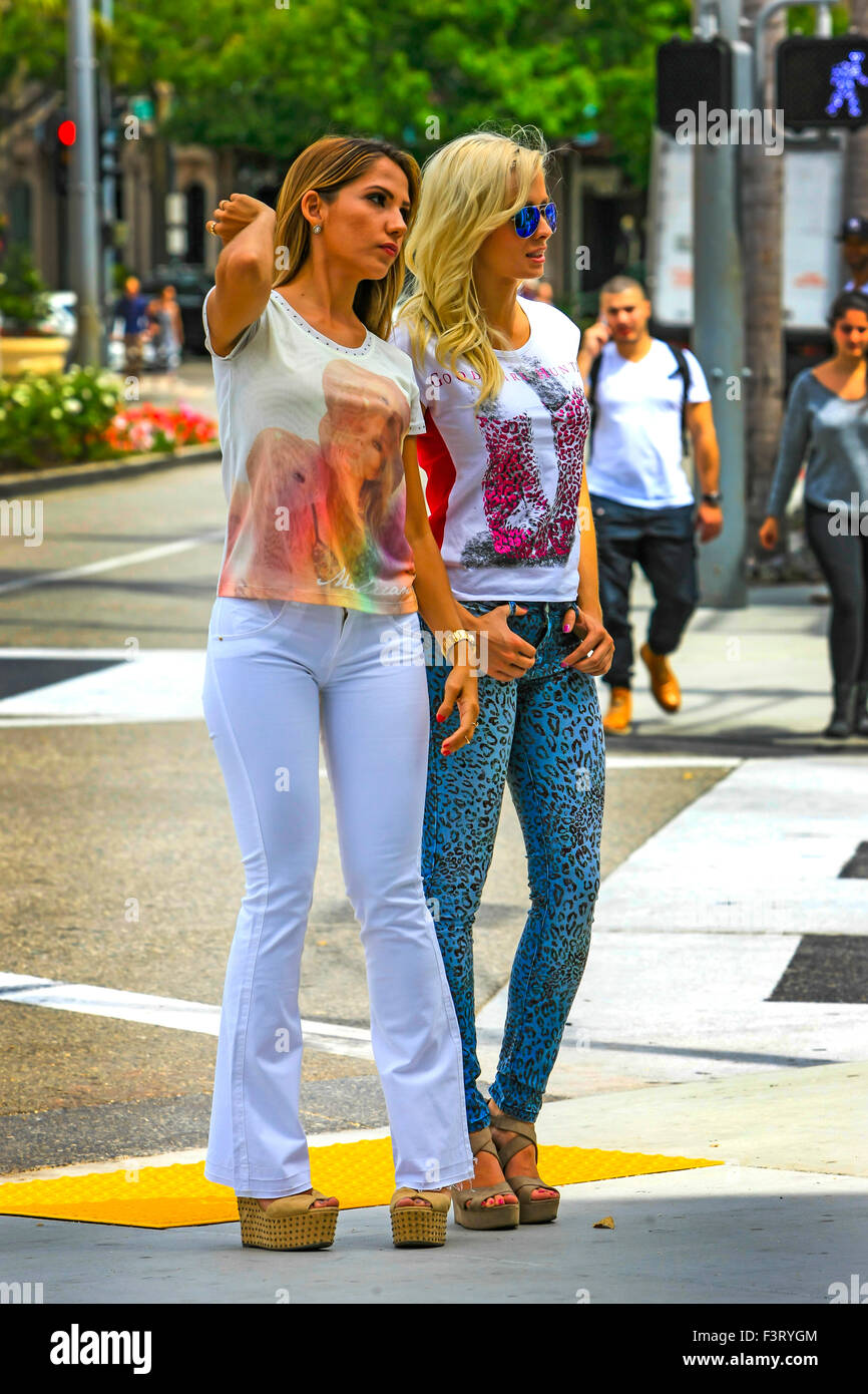 Two fashion models strutting their stuff on Rodeo Drive in Beverly Hills California - Stock Image