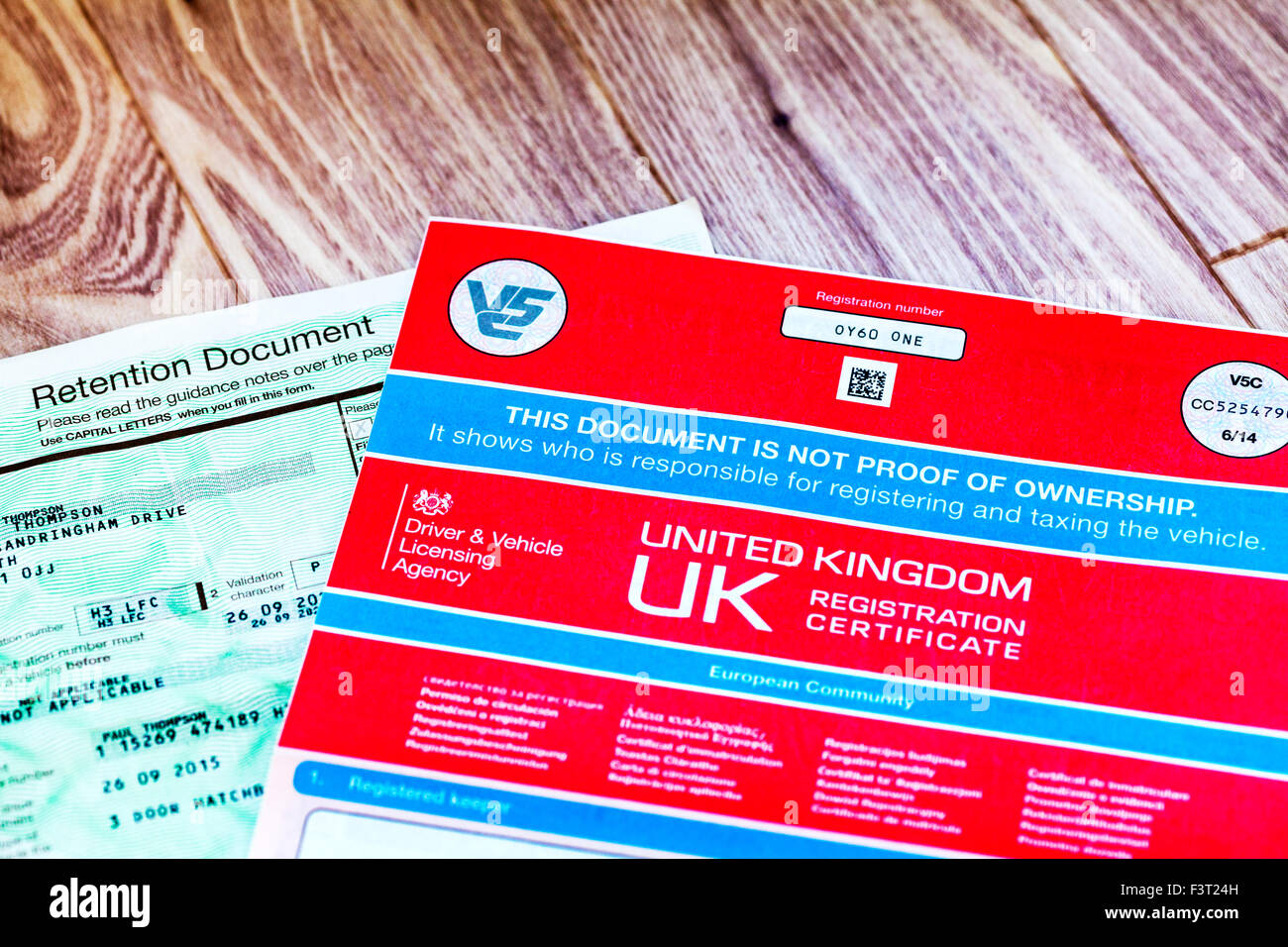 Retention document private number plate and v5c car registration certificate log book owner ownership proof UK england - Stock Image