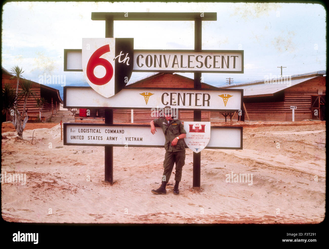 An American solider of the United States Army stands next to the sign for the 6th Convalescent Center at Cam Rahn - Stock Image