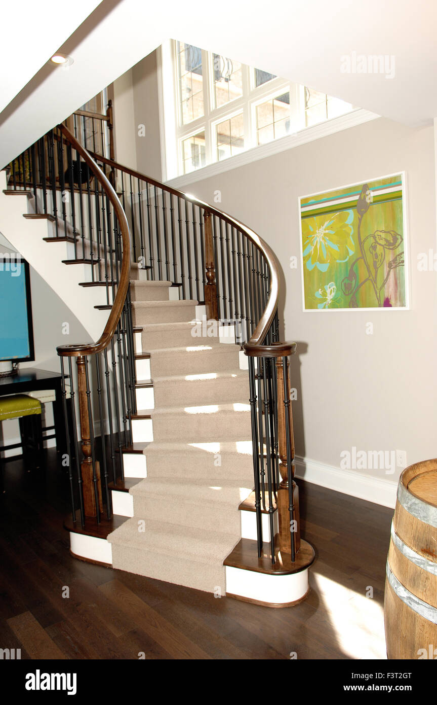 A Round Staircase To The Basement Bar In A New House With ...