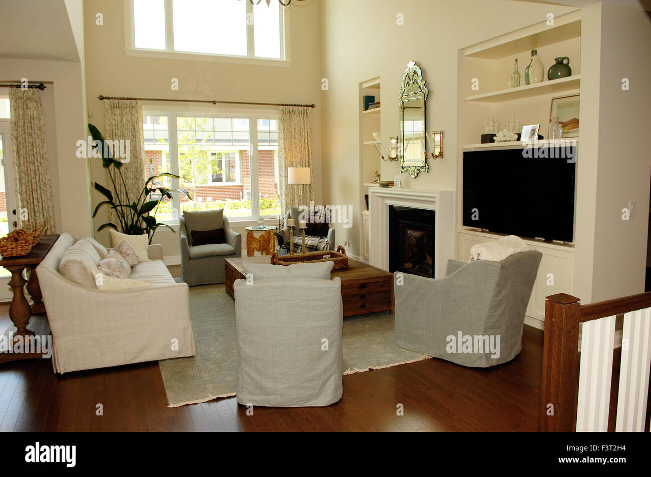 A Great Elegant Living Room With High Sealing And Window S Fireplace Stock Photo Alamy