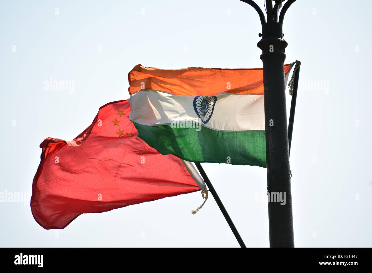 Chinese and Indian Flag on poll - Stock Image