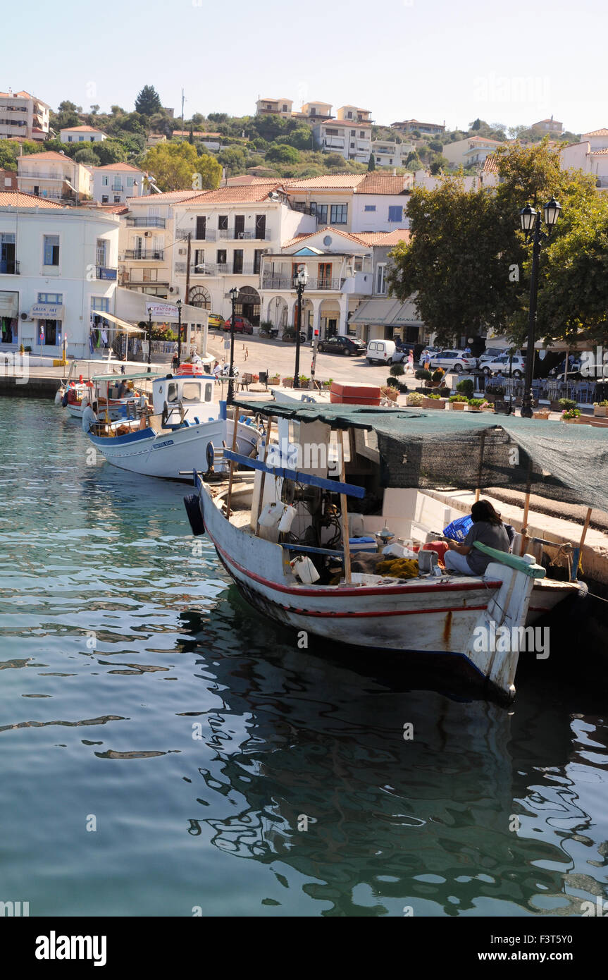 A small local fishing boat tied up and sorting its catch in the port of Pylos in the Greek Peolopnnese. - Stock Image