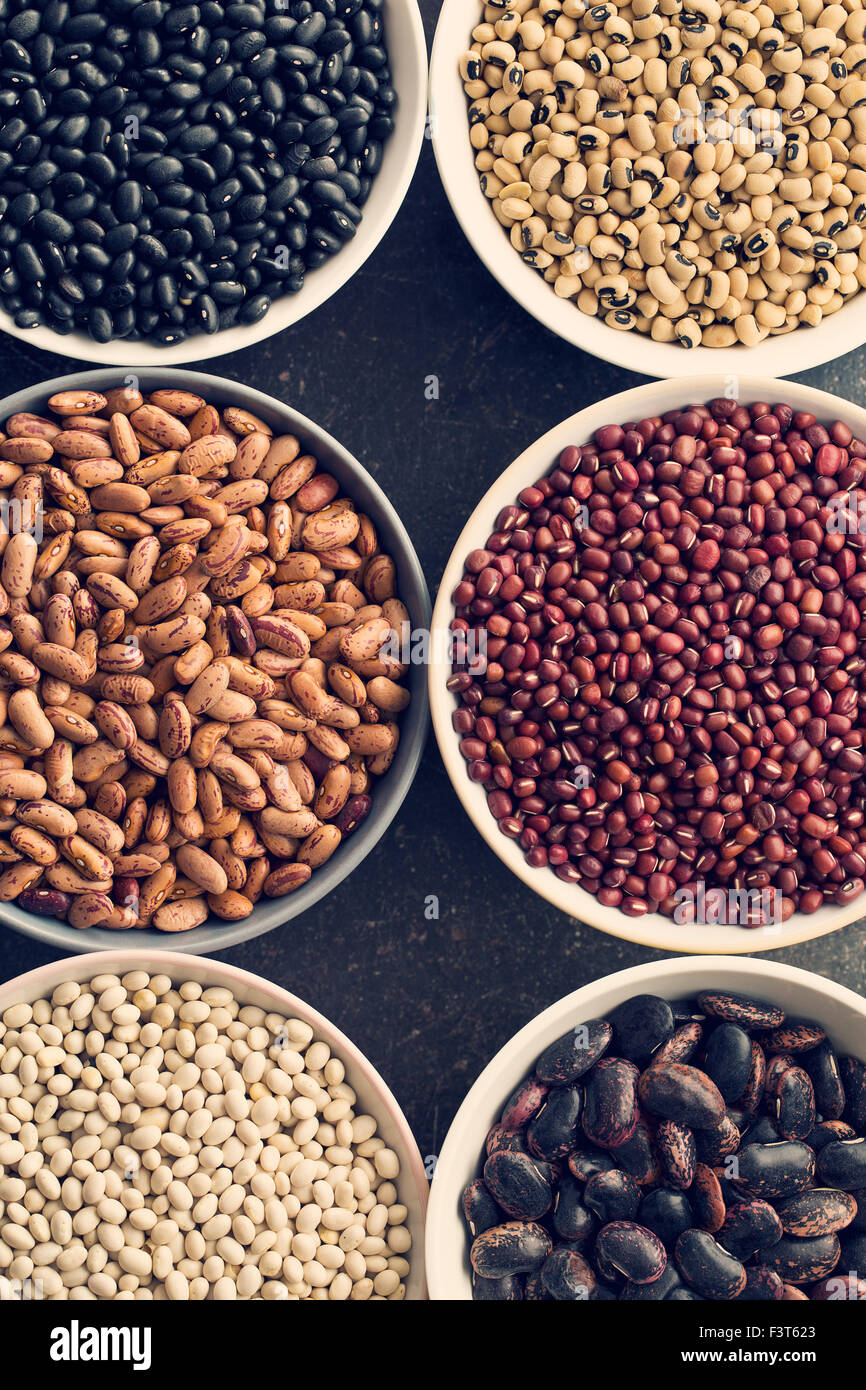 various legumes in different bowls - Stock Image