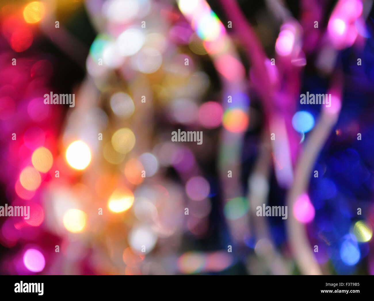 Blurred christmas lights background. De focused Light - Stock Image