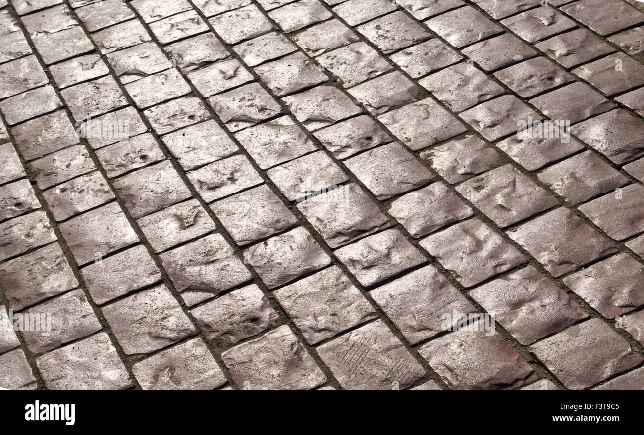 Abstract background of old cobblestone pavement - Stock Image