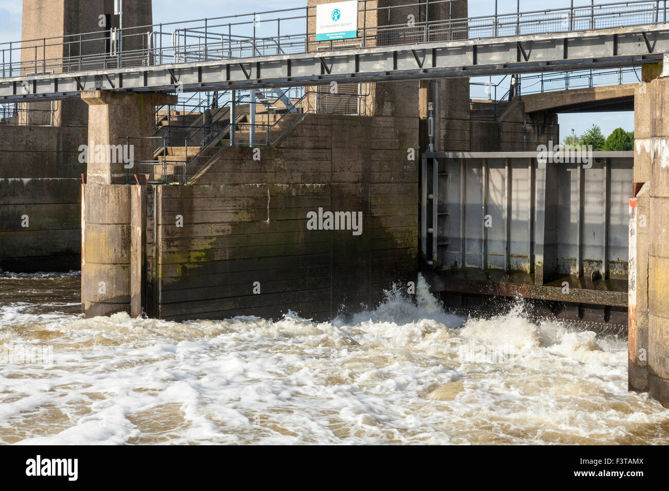 Sluice gates at Holme Sluices managed by the Environment Agency on the River Trent at Colwick, Nottingham, England, - Stock Image