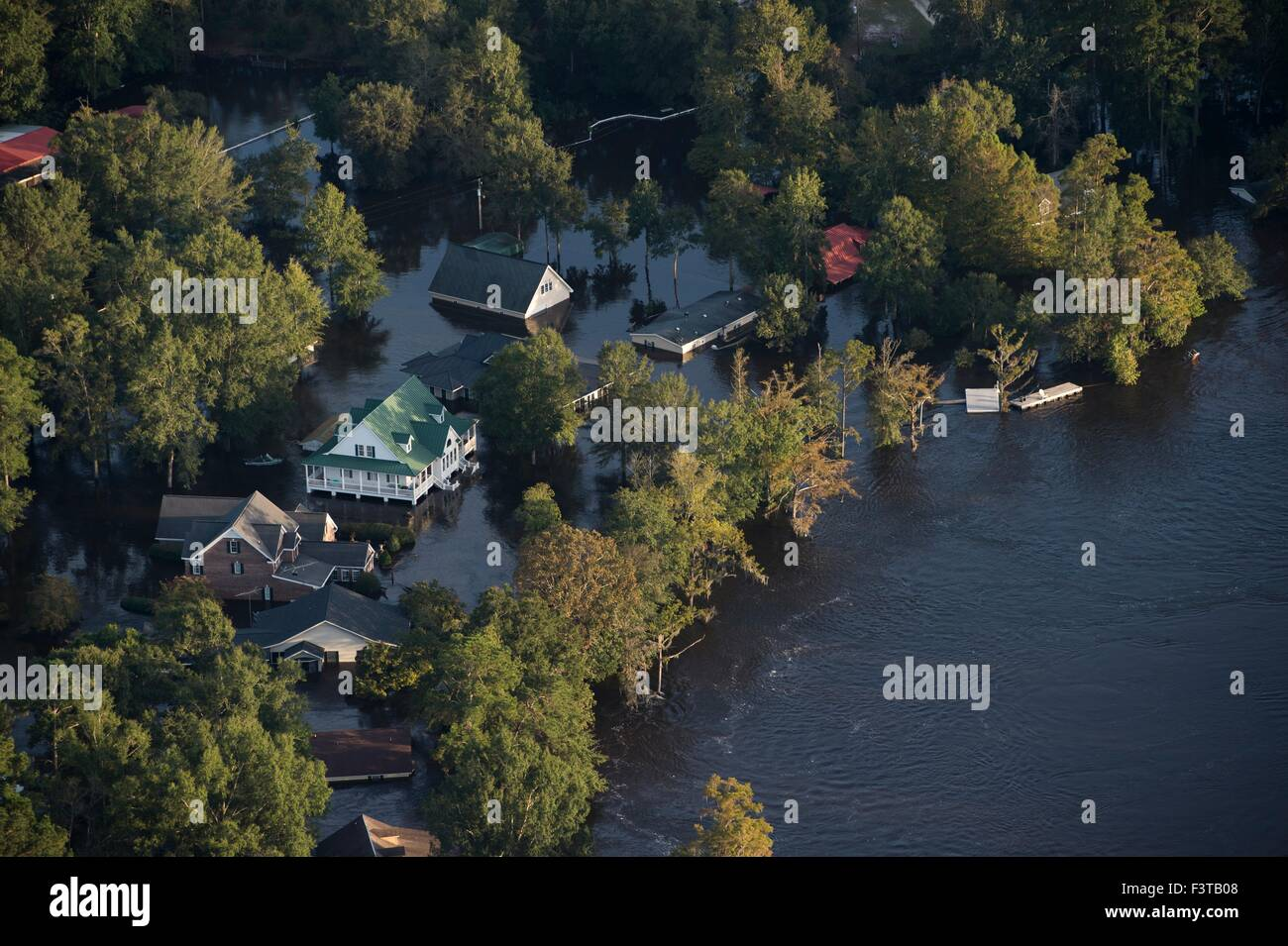 Aerial view of homes submerged in floodwaters after record breaking storms dumped more than two feet of rain October 9, 2015 in Andrews, South Carolina. At least 17 people have died from the floods that effected most of South Carolina. Stock Photo