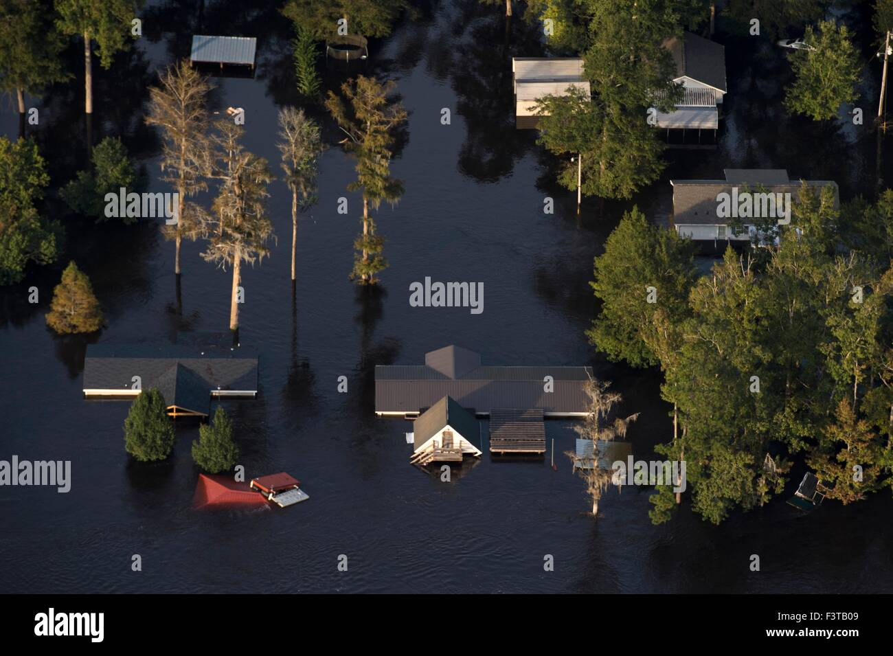 Aerial view of homes submerged in floodwaters after record breaking storms dumped more than two feet of rain October 9, 2015 in Georgetown, South Carolina. At least 17 people have died from the floods that effected most of South Carolina. Stock Photo