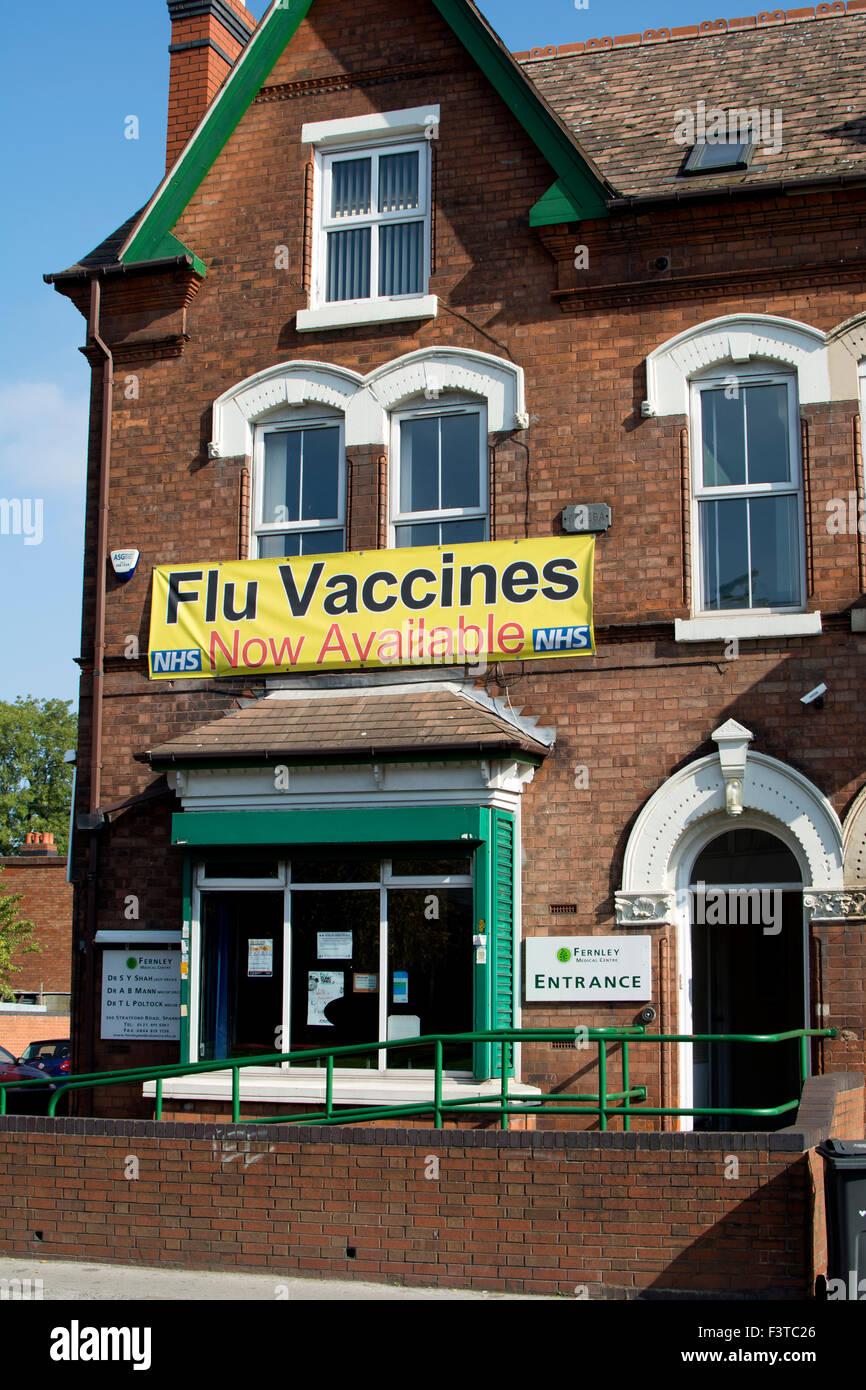 Flu Vaccines sign at a medical centre, Sparkhill, Birmingham, West Midlands, UK - Stock Image