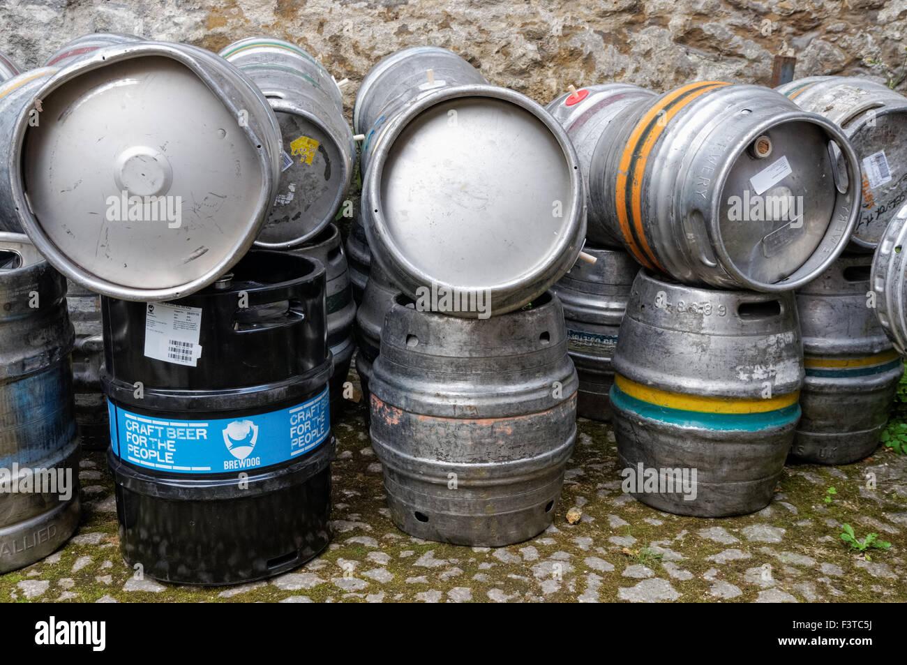 Beer casks outside a pub in Oxford Oxfordshire England United Kingdom UK - Stock Image