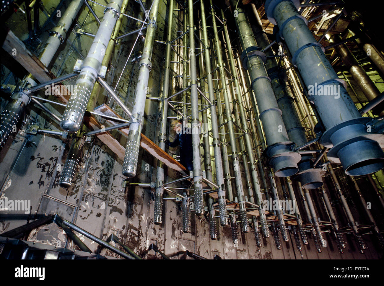 Technician working on cooling rods, interior of nuclear power plant near Stockholm, Sweden - Stock Image