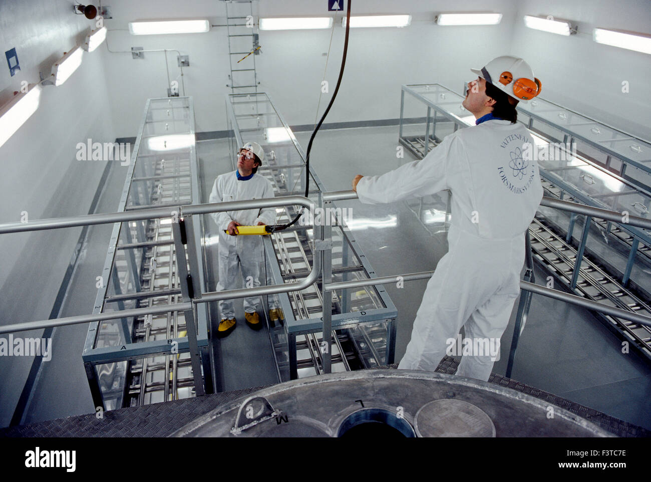 Technicians inside nuclear power plant near Stockholm, Sweden - Stock Image