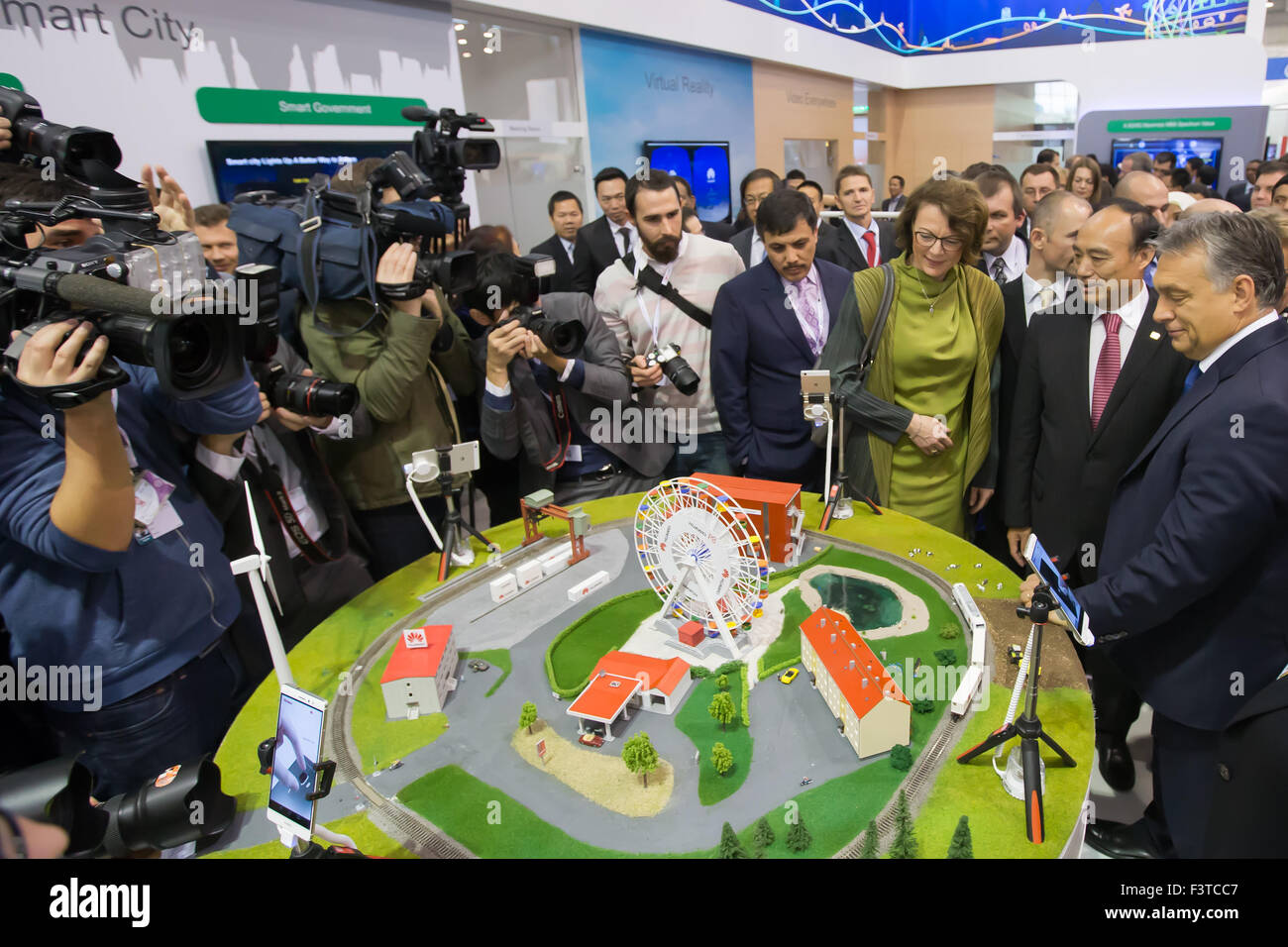Budapest. 12th Oct, 2015. Hungarian Prime Minister Viktor Orban (1st R) and ITU Secretary-General Zhao Houlin (2nd - Stock Image