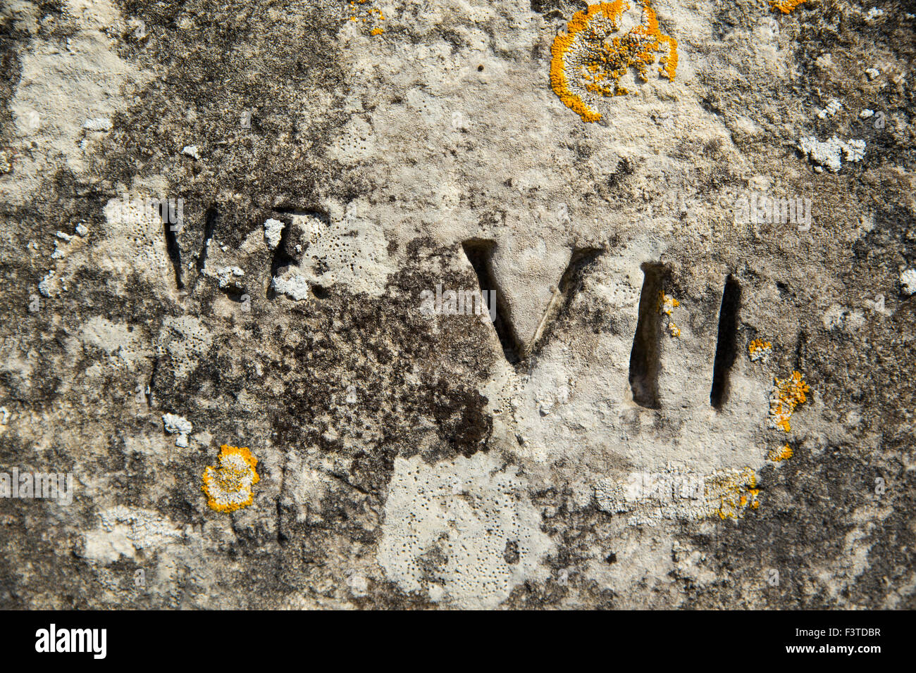 Roman numerals on wall La Rochelle in France - Stock Image
