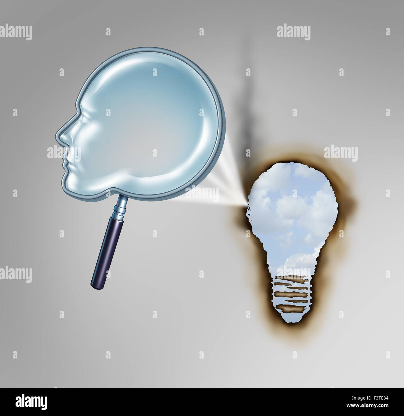 Human creativity concept as a magnifying glass shaped as a head profile creating a hot beam of light burning a hole - Stock Image