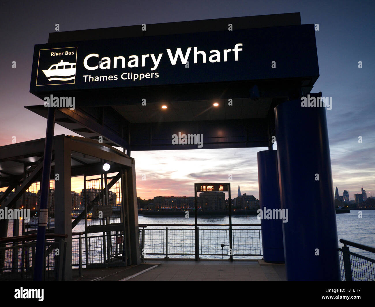 Pier embarkation point for Thames Clipper River boats, Columbia Wharf Shard & City buildings behind, Canary - Stock Image