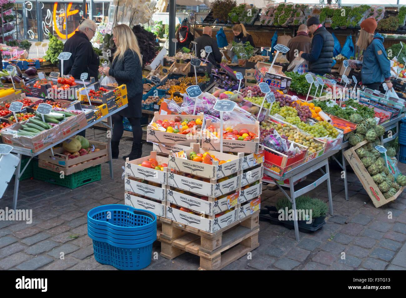 Outdoor fruit and vegetable stalls at Torvehallerne, the covered food market,  at Israels Plads in Copenhagen, Denmark - Stock Image