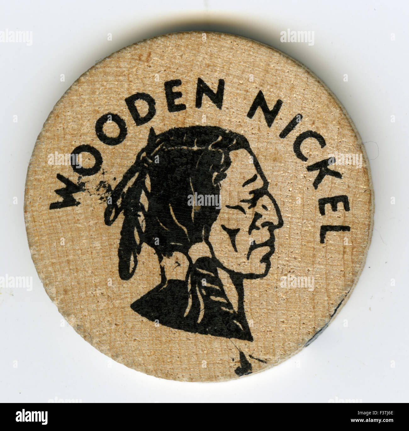 Wooden nickel given to other soldiers by members of Company H 75th Rangers LRRPs during the Vietnam War - Stock Image
