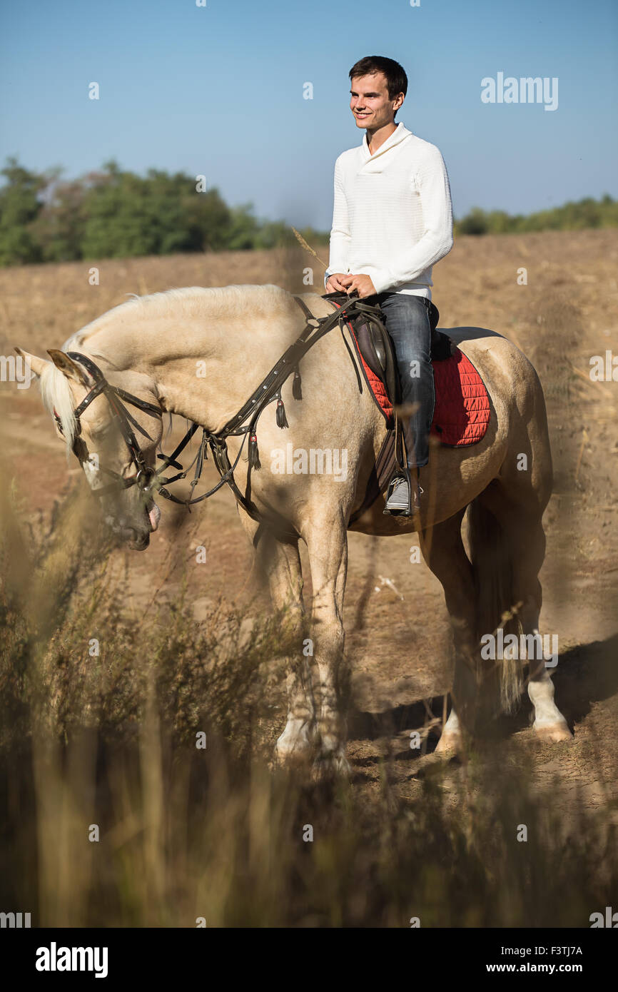 Attractive man on horseback, - Stock Image