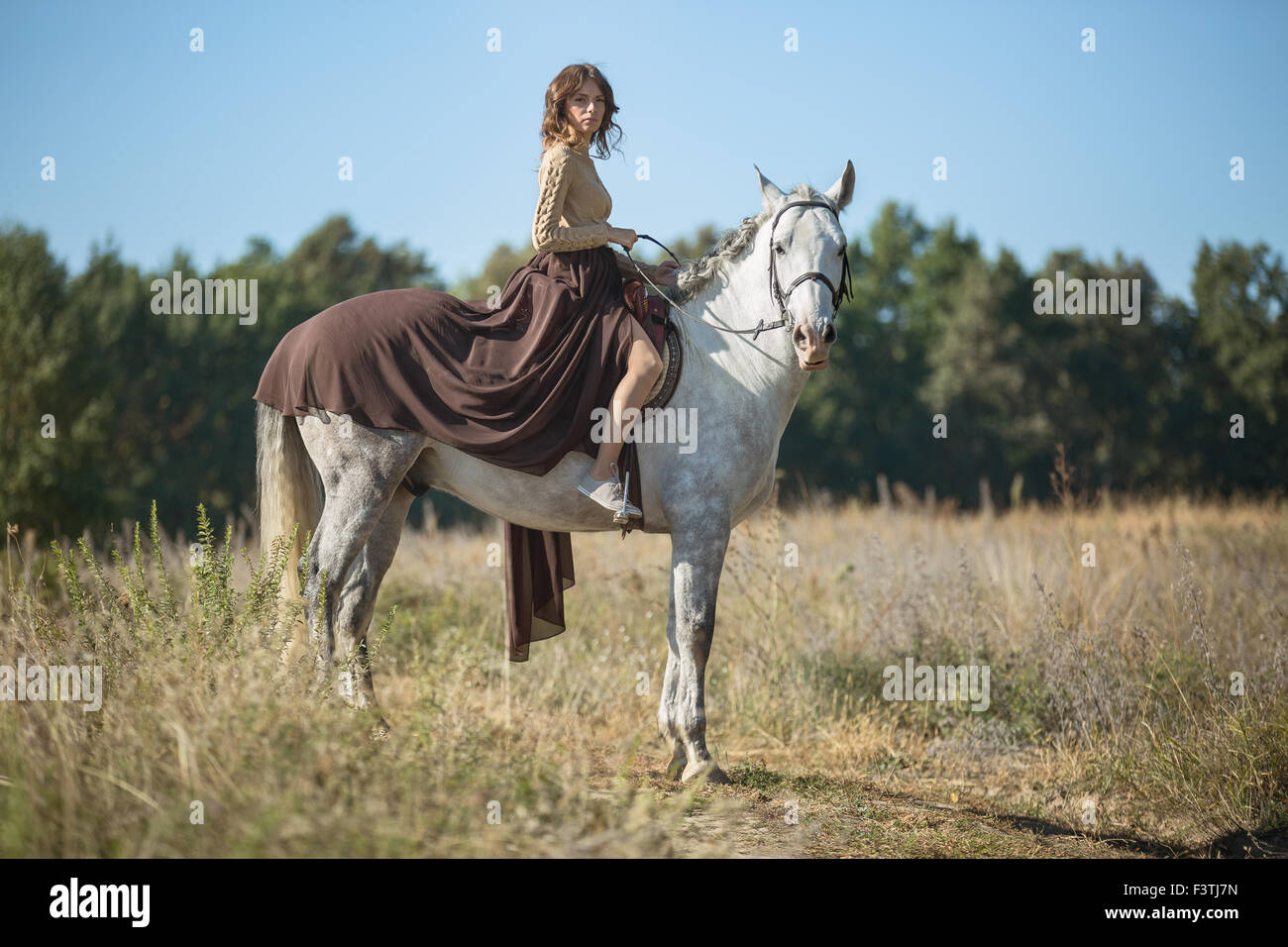 Beautiful girl riding - Stock Image