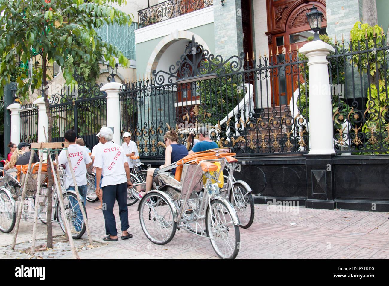 Cyclo transport city tour group in Ho Chi Minh Saigon,Vietnam,Asia - Stock Image