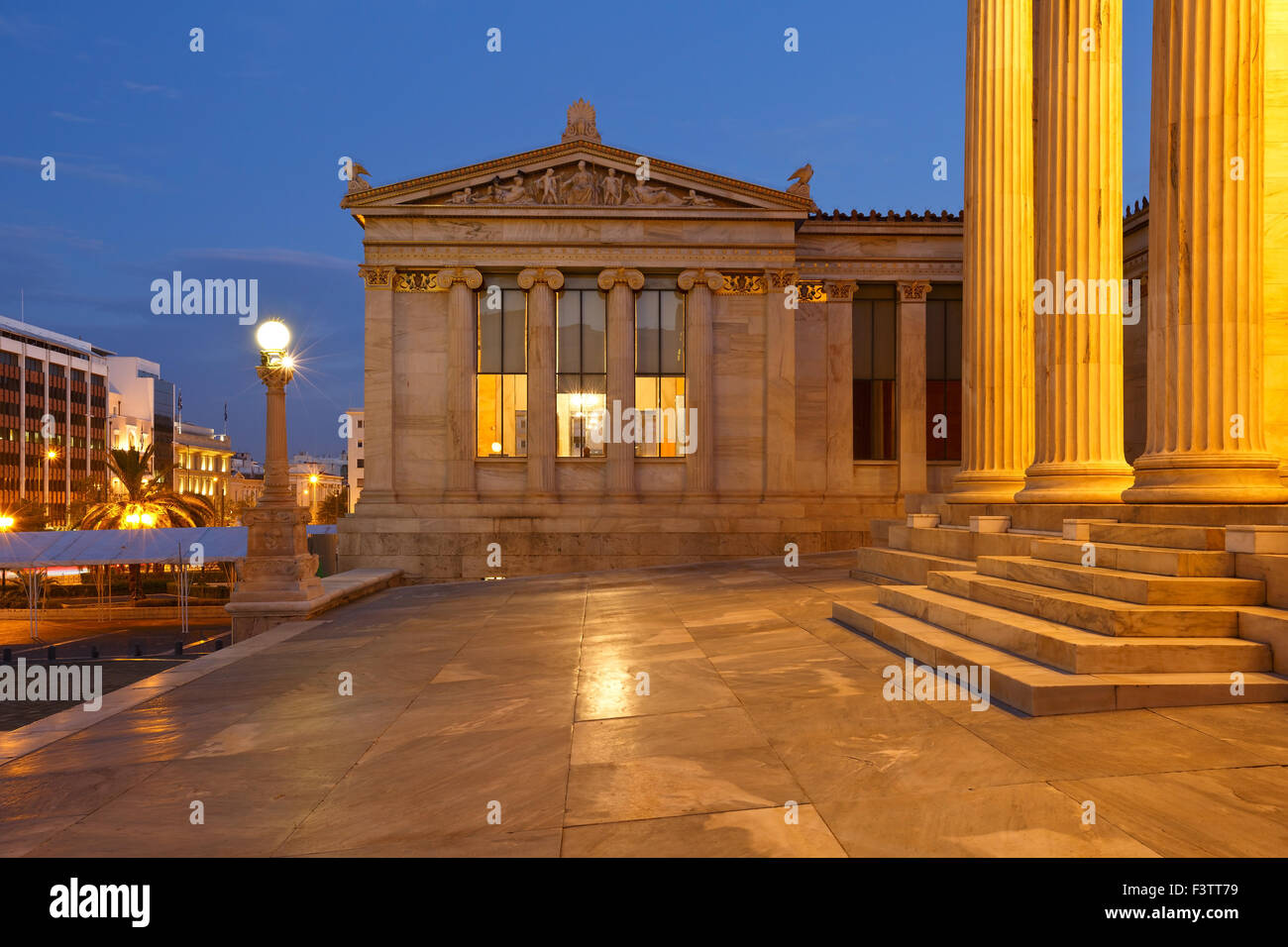 Building of the modern Academy of Athens in Panepistimio and view of Panepistimiou street - Stock Image