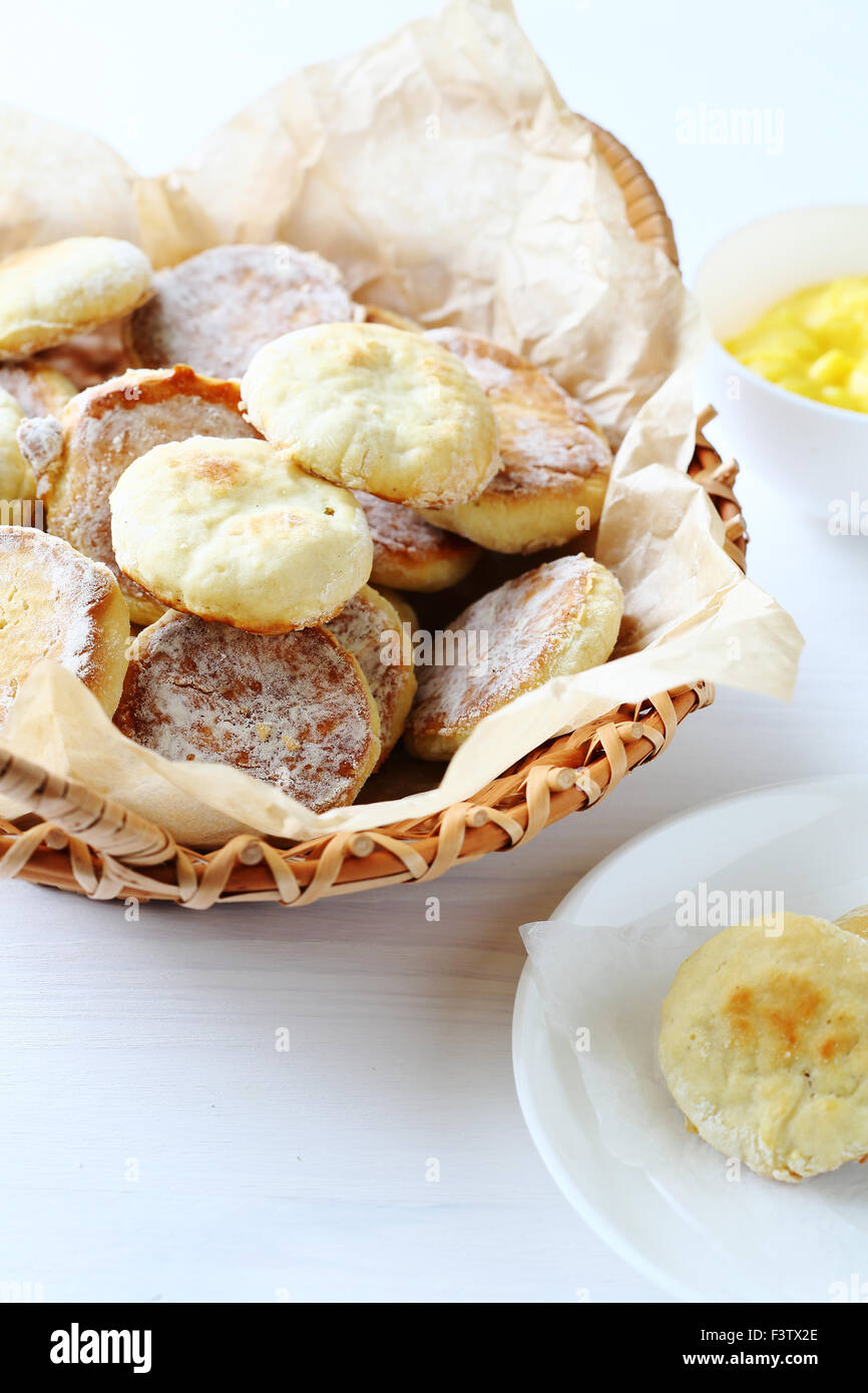 scones in basket and cream in bowl, food - Stock Image