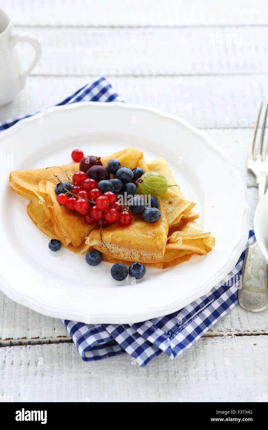 pancakes with wild berries, food - Stock Image