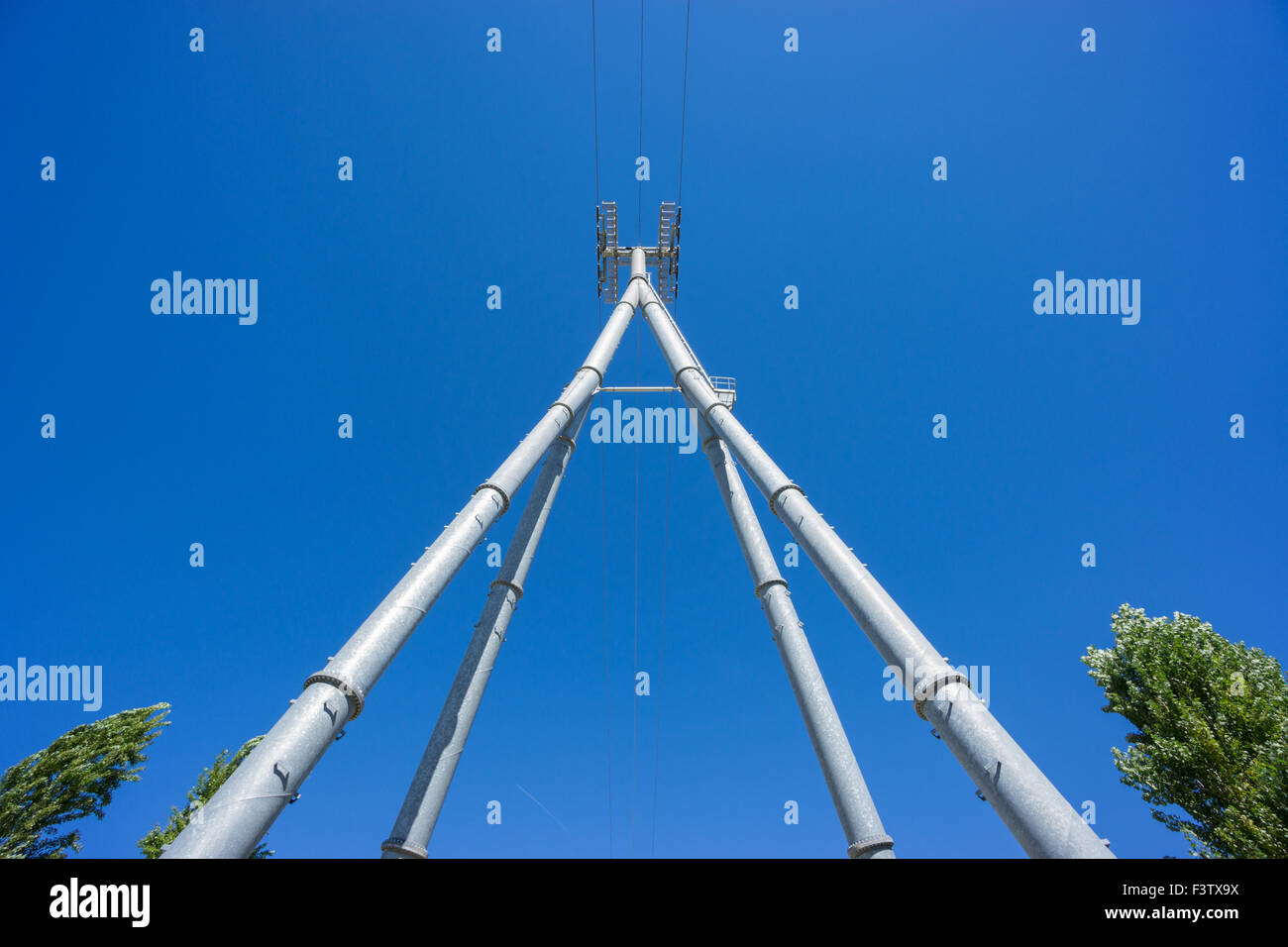 Wide Railway catenary against a blue sky Stock Photo
