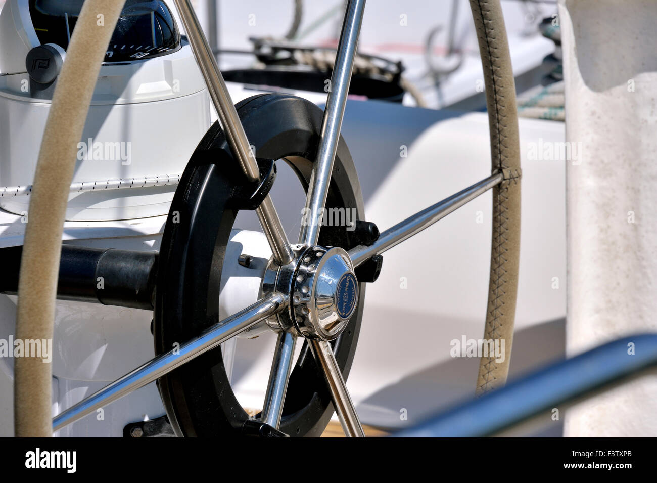 Steering wheel of sailing boat - Stock Image
